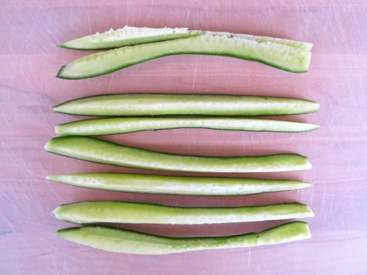 Cucumber sliced lengthwise into 8 pieces.