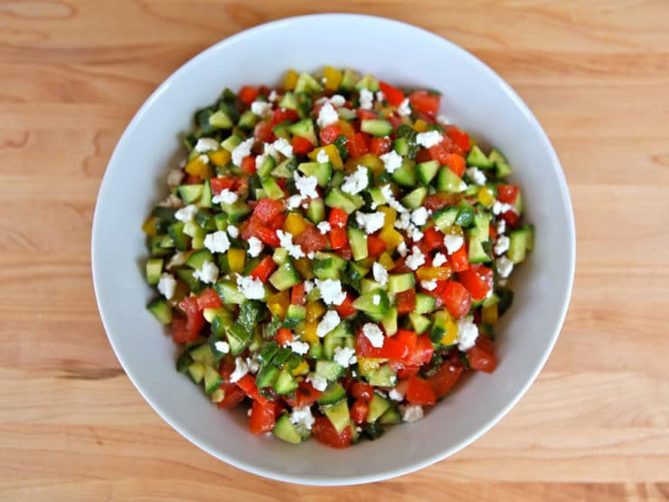 Israeli Salad With Feta and Mint - Israeli Salad dressed up with feta cheese, fresh mint, sweet bell peppers, olive oil, lemon, and cinnamon. Kosher, Dairy, Vegetarian, Side Dish