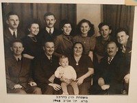 The Levin Family in 1945 - back (left to right): Zalman, Yaffa, Aizik, Sara, Bella, Yankalla, Dov; front: Tzvi, Arieh, Safta Esther Malca holding Shlomo, Sabba Yitzhak