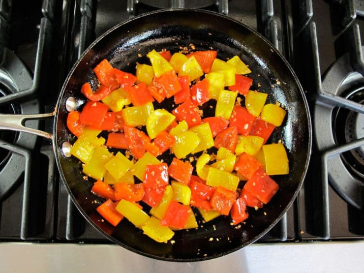 Chopped bell pepper in a skillet.
