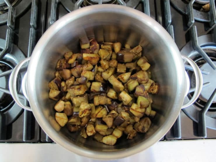 Eggplant cubes in a stockpot.