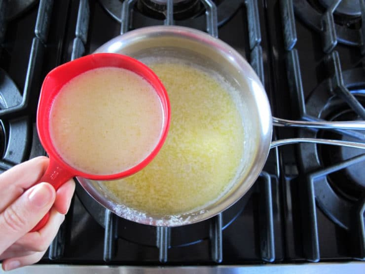 Remove one cup of hot butter from the saucepan.