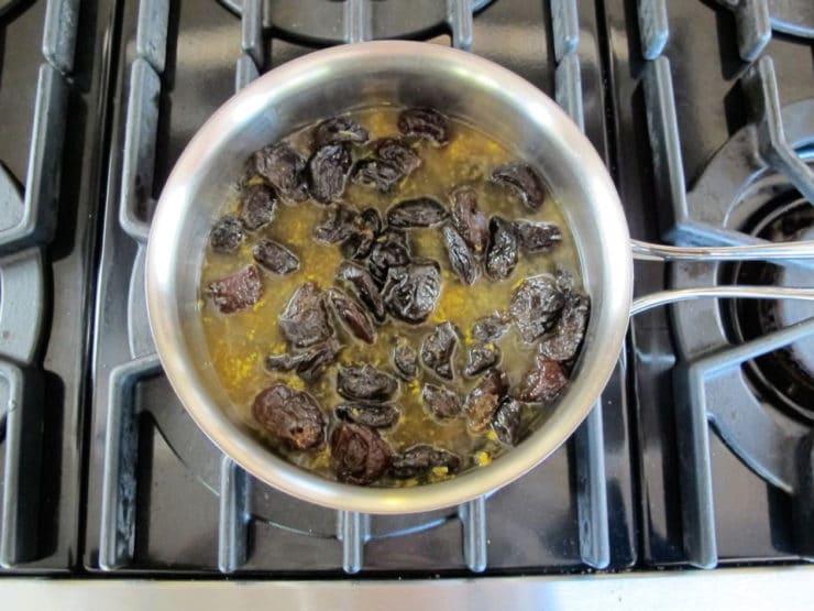 Prune filling simmering in a saucepan.