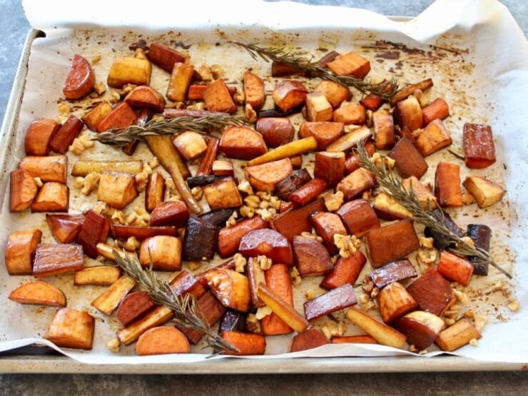 Roasted root veggies on tray with rosemary