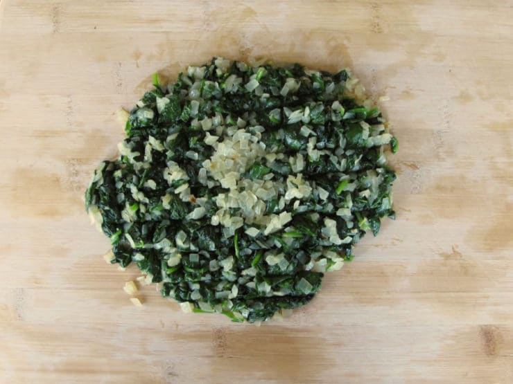 Chopped spinach on a cutting board.