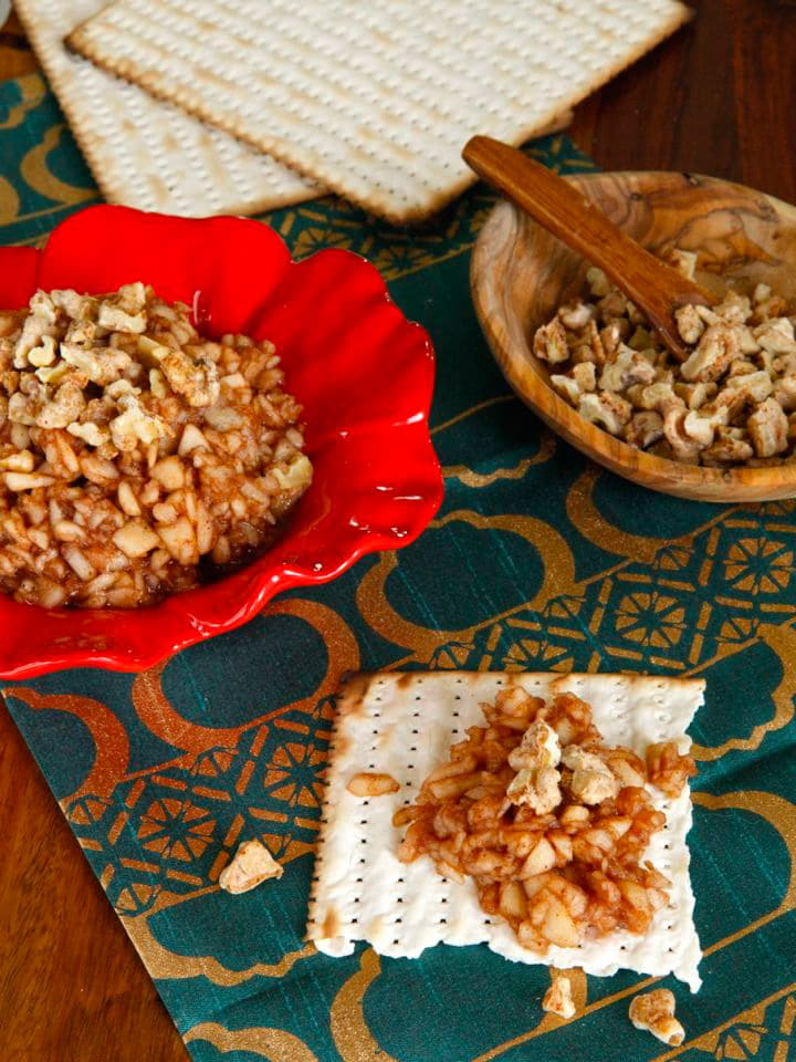 Apple Cinnamon Charoset with Cayenne Candied Walnuts - Traditional Passover apple charoset topped with spicy, crunchy walnuts for a unique spin on a classic recipe.