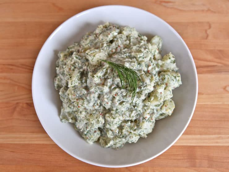 Potato Salad with Dill and Dijon - A unique and flavorful chilled salad recipe with new potatoes, mayonnaise, whole grain dijon mustard, vinegar and fresh dill.