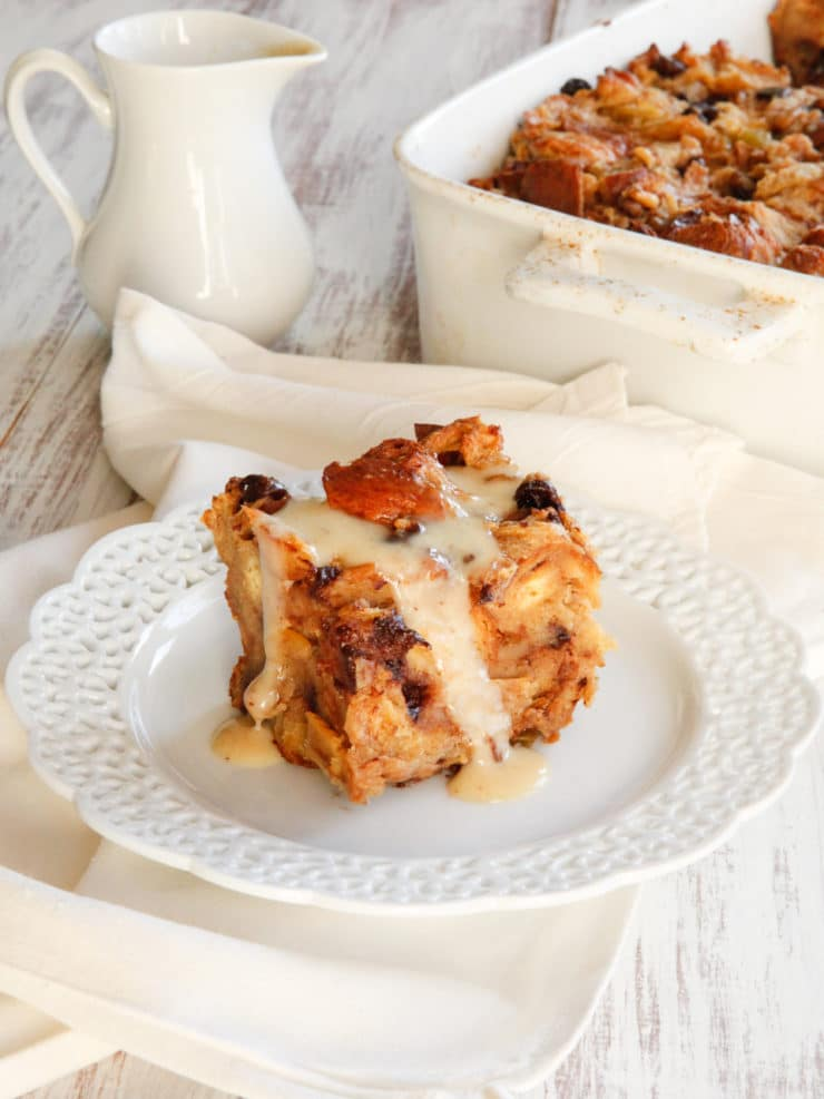 "Challah Bread Pudding with Kahlua Cream Sauce Recipe - A rich and decadent bread pudding recipe featuring eggy challah, raisins or chocolate chips, and luscious Kahlua cream sauce. My ""famous"" family recipe!"