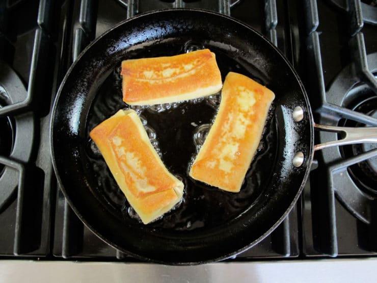 Frying blintzes in a skillet.