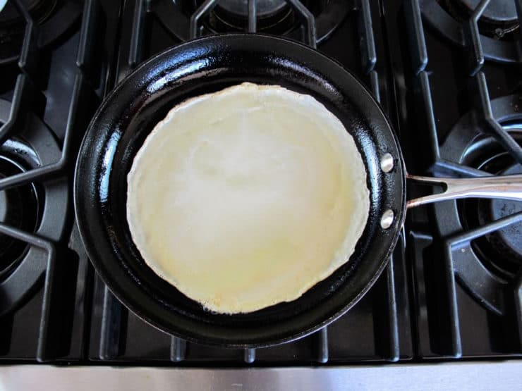 Blintz batter in a hot skillet.