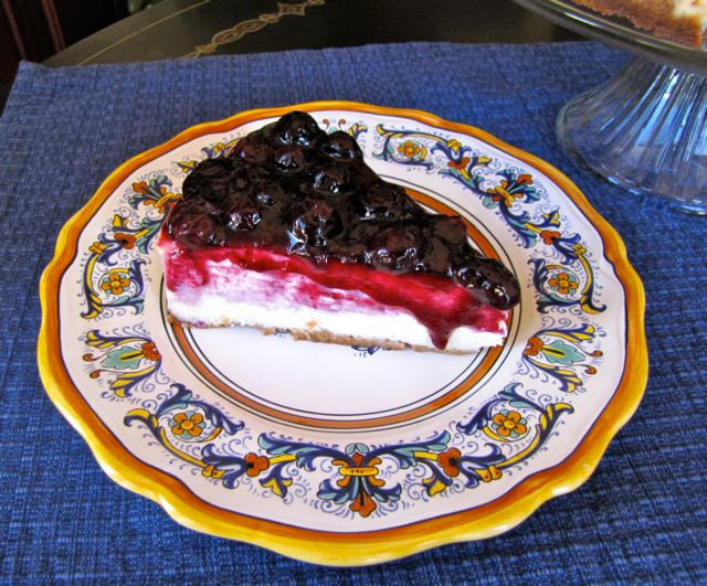 Blueberry Cheesecake on a fancy plate.