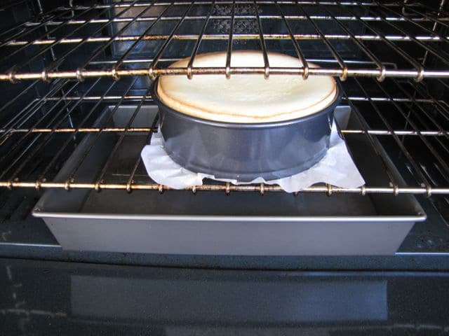 "Cheesecake in the oven over a ""steam bath."""