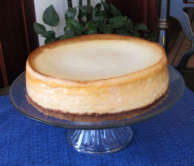 Finished cheesecake on a stand.