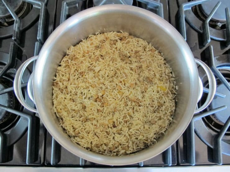 Cooked rice and lentils in a stockpot.