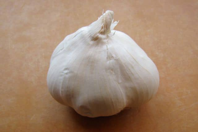 How to Roast Garlic - Learn a simple method for oven-roasting garlic. Makes milder, sweeter, caramelized garlic cloves that add flavor and depth to your recipes.