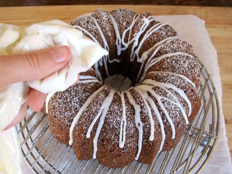 Drizzling icing over a bundt cake.