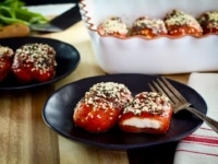 Stuffed Peppers with Goat Cheese - Recipe for roasted bell peppers filled with soft goat cheese, topped with herbs and baked.