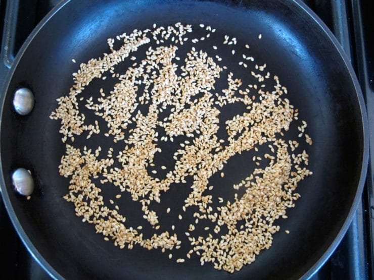 Dry toasting sesame seeds in a skillet.
