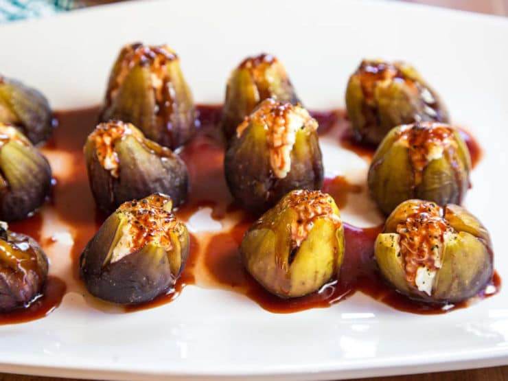 Stuffed Figs with Goat Cheese - Recipe for fresh figs stuffed with goat cheese, roasted and topped with date honey. Simple and scrumptious appetizer, all natural finger food.