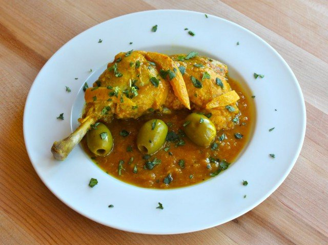 Moroccan Lemon Chicken with Olives - Learn to make a traditional Moroccan recipe for slow simmered, tender chicken with preserved lemon, olives, and spices.