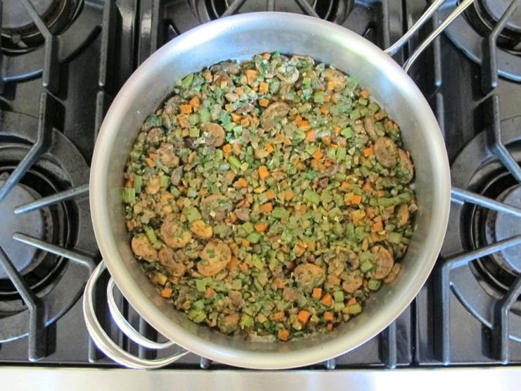 Sauteed vegetables in a skillet.