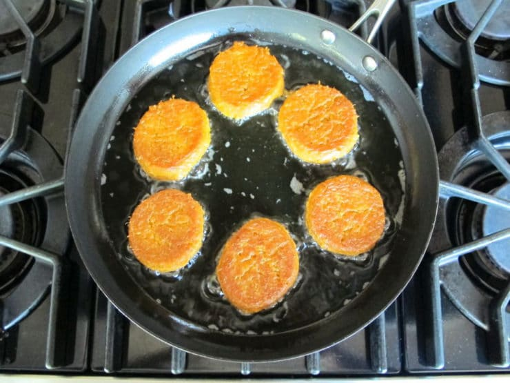 Frying chremslach in a skillet.