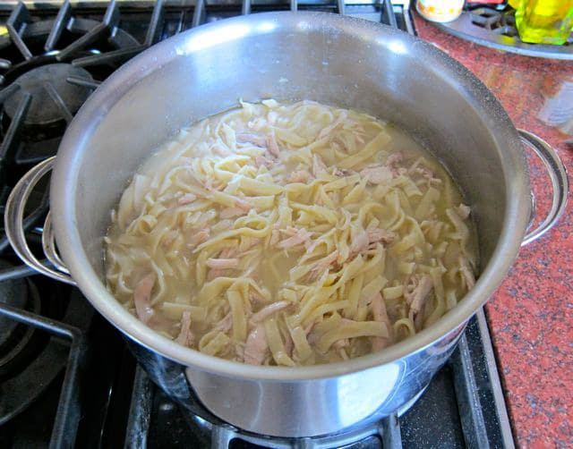 Cooking homemade noodles in broth.
