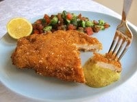 Chicken schnitzel with Israeli salad and spicy mustard