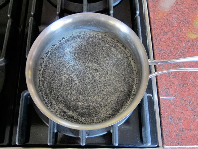 Soaking poppyseeds in water.
