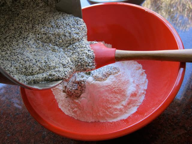 Adding butter to dry cake ingredients.