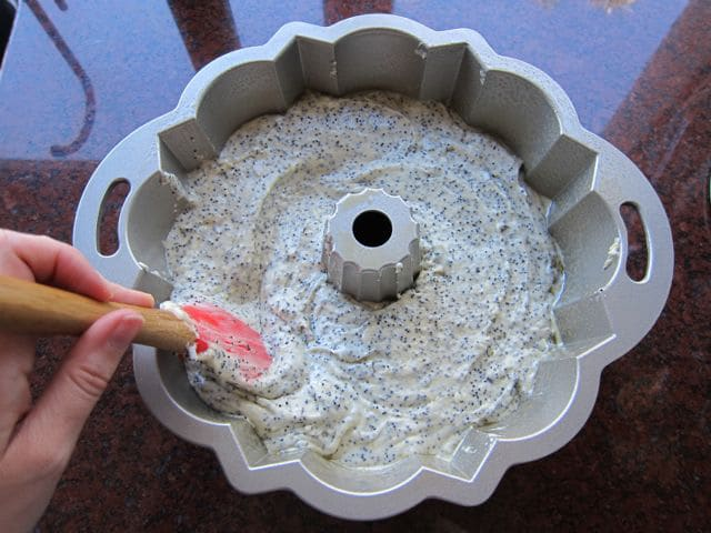 Smoothing cake batter into bundt pan.