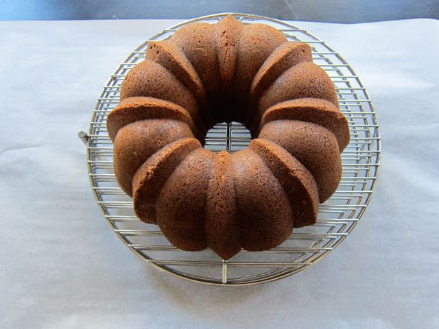 Bundt cake turned out onto a cooling rack.