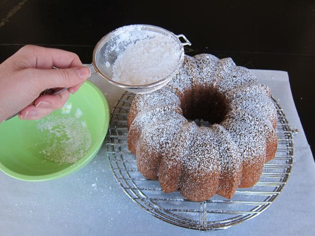 Dusting bundt cake with powdered sugar.