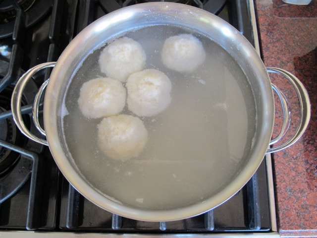 Cooking potato balls in hot water.