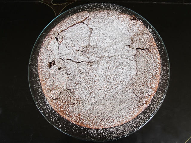 Chocolate cake dusted with powdered sugar.