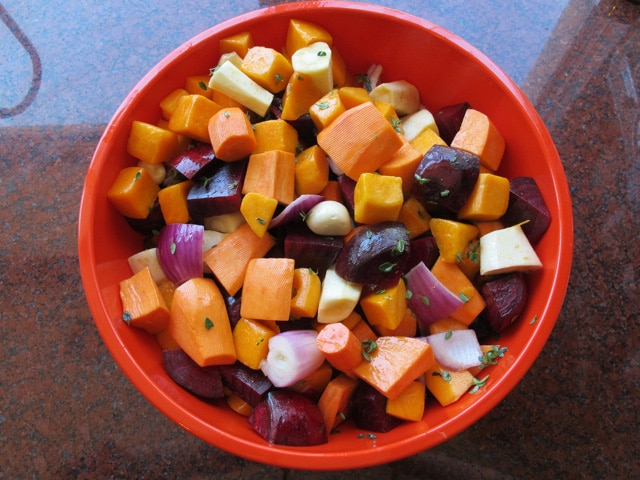 Chopped root vegetables in a large bowl.