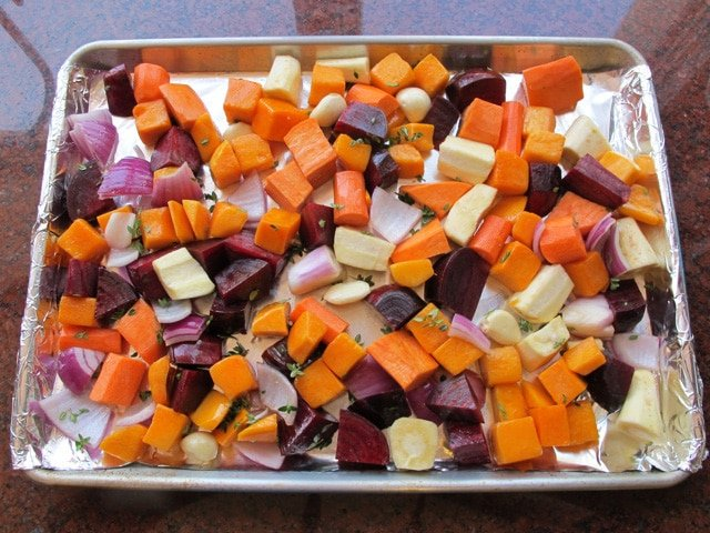 Chopped root vegetables on a baking sheet.