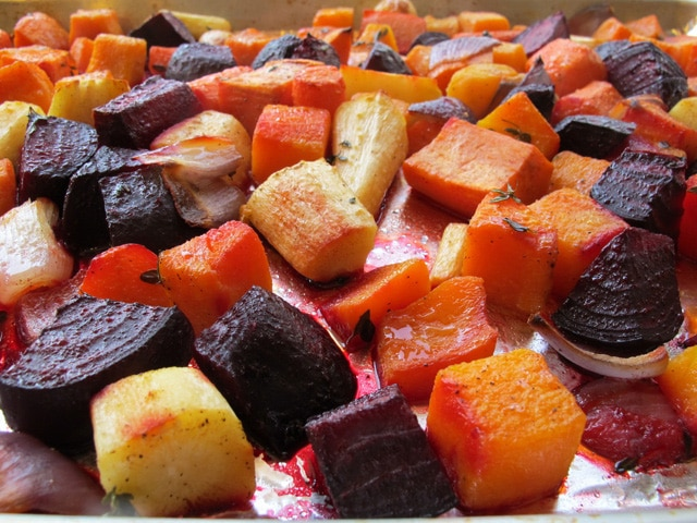 Oven Roasted Root Vegetables -  Easy and colorful vegetable side dish with root vegetables, garlic, thyme and olive oil. Vegan, pareve, gluten free, kosher for Passover.