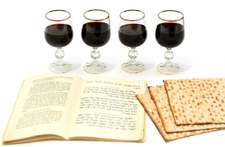 Celebrating Passover with four glasses of wine, a Haggadah and matzo