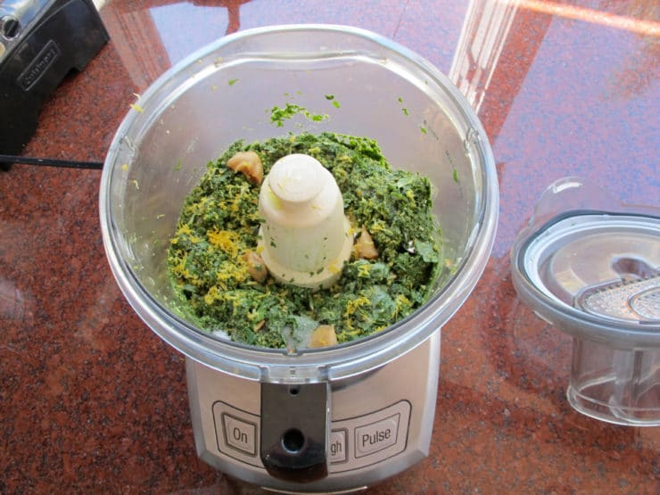 Processing pesto in a food processor.