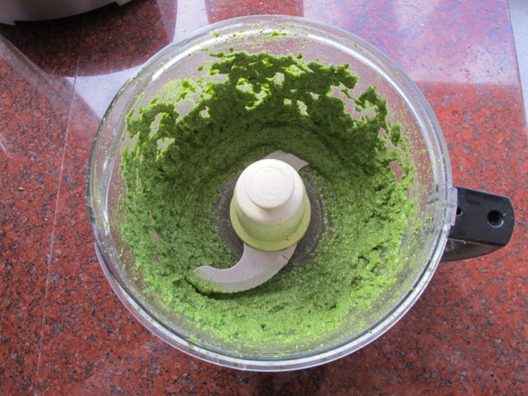 Pesto becoming creamy in the food processor.