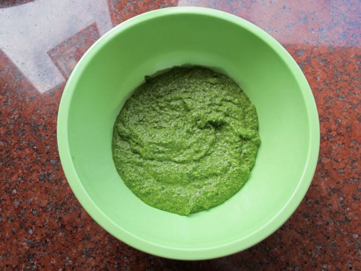 Pesto in a mixing bowl.