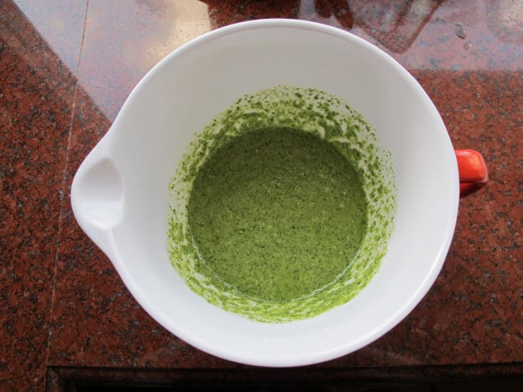 Basil pesto in a mixing bowl.