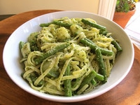 Cooked pasta and vegetables tossed in pesto.