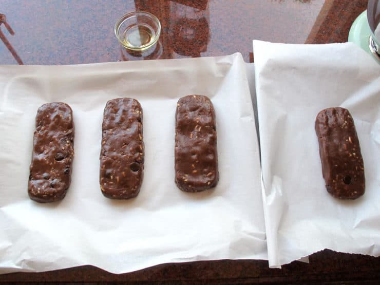 Cookie dough shaped into short logs.