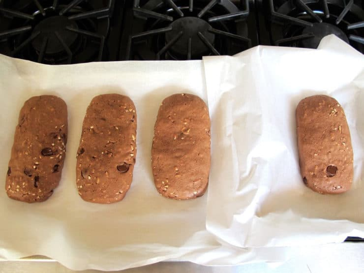 Baked cookie logs on a sheet.