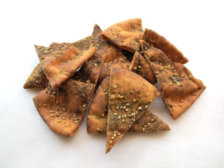Baked pita chips in a pile.