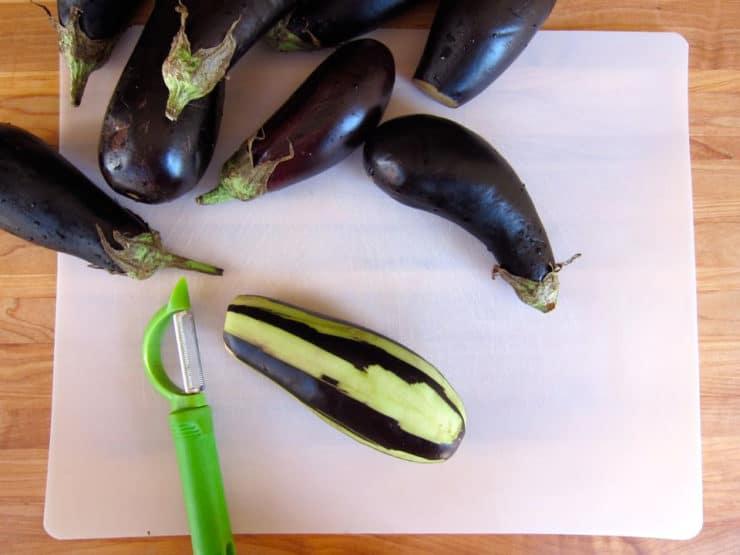 Peeling eggplant.