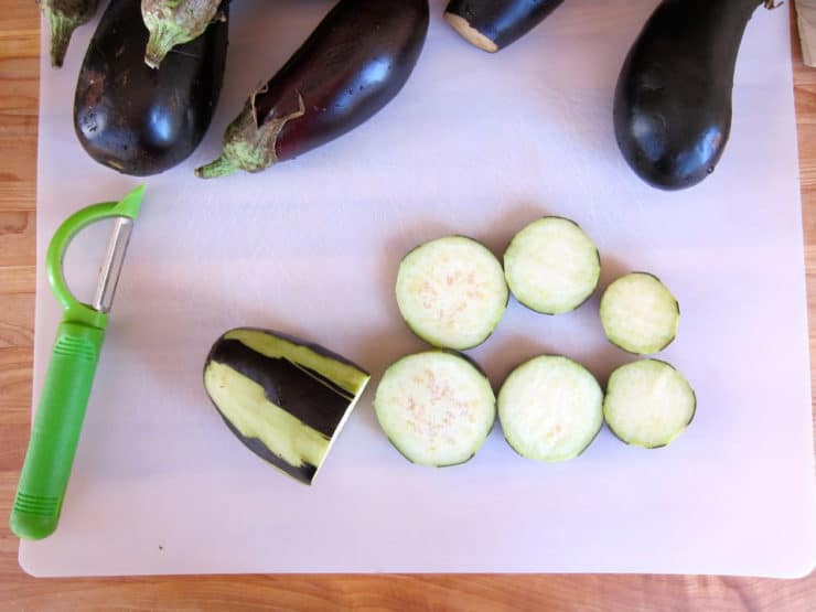 Slicing eggplant into rounds.