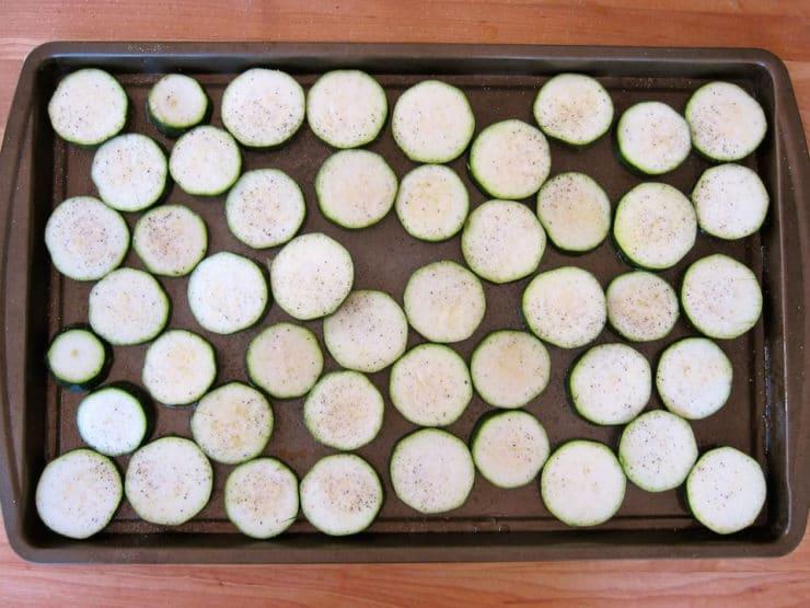 Sliced potatoes on a baking sheet.